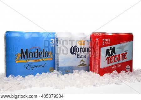 IRVINE, CALIFORNIA - MARCH 21, 2018: Three packs of 24 ounce Mexican Beers. Modelo Especial, Corona Extra and Tecate Original with ice.