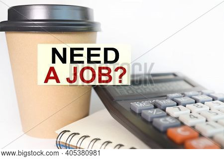 Need A Job , Text On Sticker. The Sticker Is Glued To A Disposable Coffee Cup.