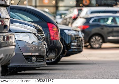 A Row Of Cars In The Parking Lot Outside The Office Building, Close-up