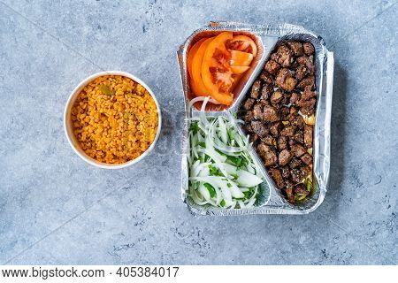Turkish Take Away Kebab Liver With Onions And Tomatoes In Tabldot Foil Plate. Served With Bulghur Or