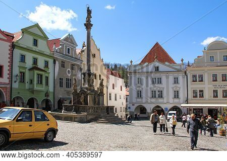Cesky Krumlov, Czech - April 25, 2012: These Are The Fountain And The Plague Column In Svornosti Squ