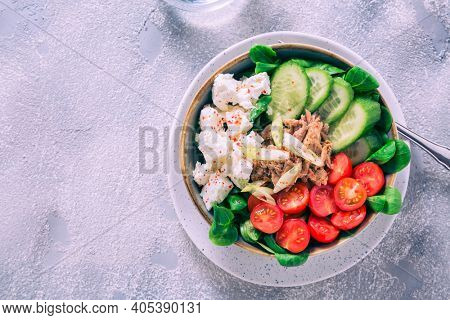 Vegetarian buddha bowl. Raw vegetables and tuna in a one bowl. Vegetarian, healthy, detox food concept