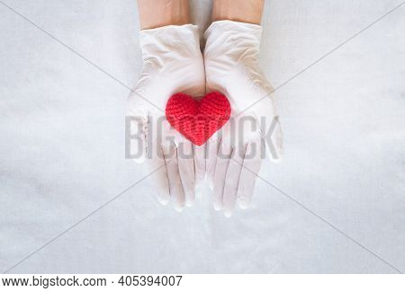 Hands With Glove Holding Red Heart On White Background, Copy Space. Concept For Healthcare, Heart He