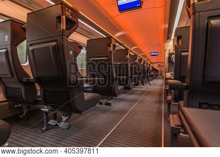 Train Compartment From The German Railways. Without Passengers In The Aisle And On The Seats. Illumi