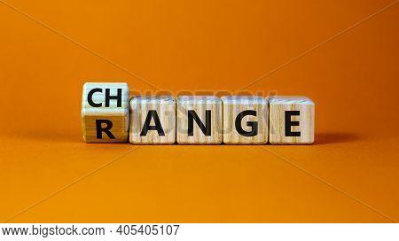 Change Range Symbol. Turned A Cube And Changed The Word 'change' To 'range'. Beautiful Orange Backgr