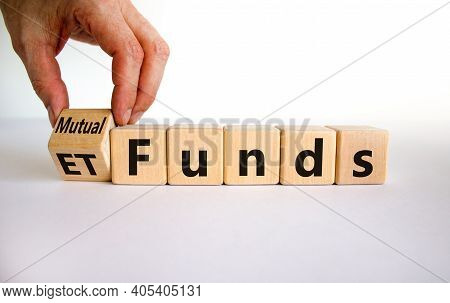 Mutual Funds Vs Etf Symbol. Businessman Turns A Cube And Changes Words 'etf' To 'mutual Funds'. Beau