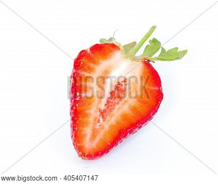 Fresh Half Cut Of Strawberry Fruit Isolated On White Background With Copy Space