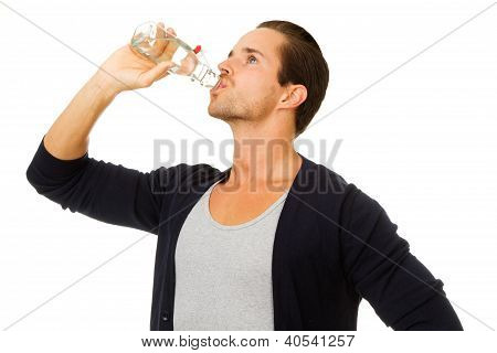 Man Drinking Water From Botttle In Profile