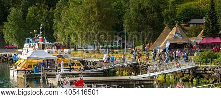 Flam, Norway - July 31, 2018: Norwegian Village At Sognefjord Fjord, Port With Boats And Tourist Ten
