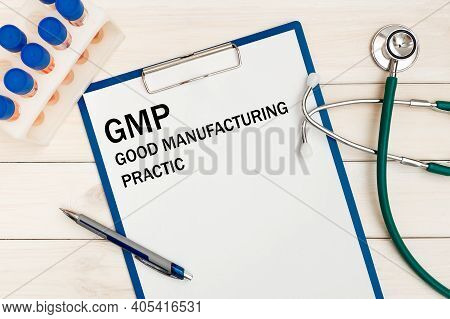 Paper With Gmp - Good Manufacturing Practice On The Office Desk, Stethoscope And Pen