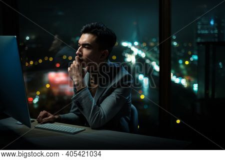 Thoughtful Man Read Business Plan on Computer