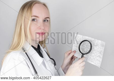 A Neurologist With A Magnifying Glass Examines An Encephalogram Of A Patient\'s Brain. Schedule Of E