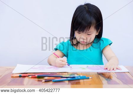 Children Are Coloring With Intent. Child And Imaginary Creativity Through Art. Kid Learn Crafts On P