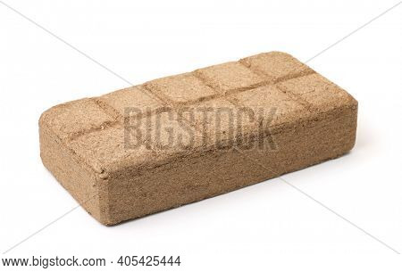 Pressed coconut peat briquette isolated on white