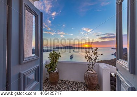 Stunning Picturesque Sunset View Through Door And Entrance In Santorini Island, Greece. Famous Trave