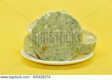 Green Vegetable Cutlets In Plate On Yellow Background. Frozen Veggie Cutlets Made From Green Vegetab