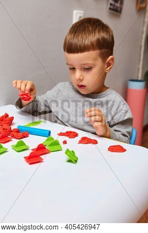 The Boy Is Playing In His Room. Young Child Playing With Play Doh Or Play Dough. Educational Toys Fo