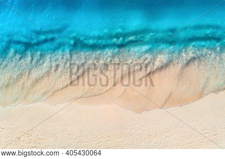 Aerial View Of Clear Blue Sea With Waves And Empty White Sandy Beach At Sunset. Summer In Zanzibar,