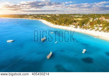 Aerial View Of The Yachts And Boats On Tropical Sea Coast With Sandy Beach At Sunset. Summer Holiday