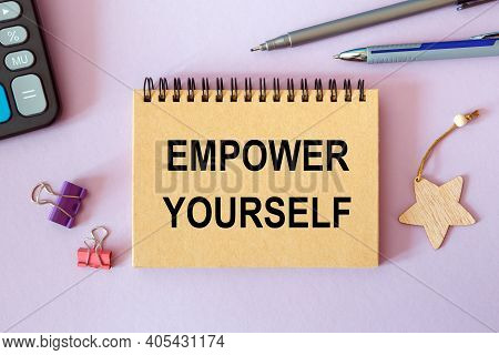 Empower Yourselfis - Written On A Notepad On An Office Desk With Office Accessories.