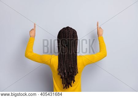 Back Rear Photo Of Young Afro Girl Point Fingers Empty Space Advert Promo Isolated Over Grey Color B