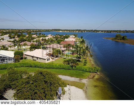 Suburban Waterfront Residential Community In Florida Aerial View