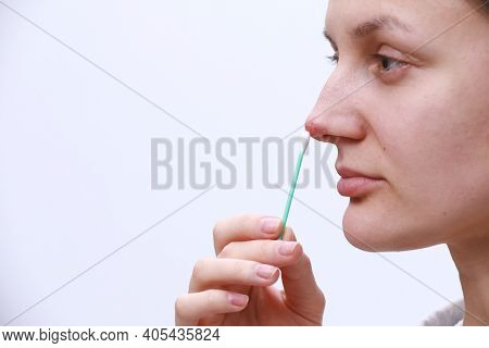 Herpes On The Nose - Pretty Young Woman Woman Holding An Ear Stick With Herpes Medicine. Human Virus