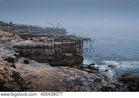 Cliff Top View Of The Jurassic Coast Cliffs During Foggy Weather At Portland Bill, Isle Of Portland,