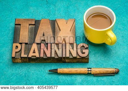 tax planning, financial concept in vintage letterpress wood type with coffee, business and tax optimization