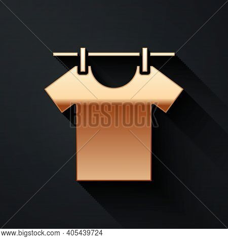 Gold Drying Clothes Icon Isolated On Black Background. Clean Shirt. Wash Clothes On A Rope With Clot