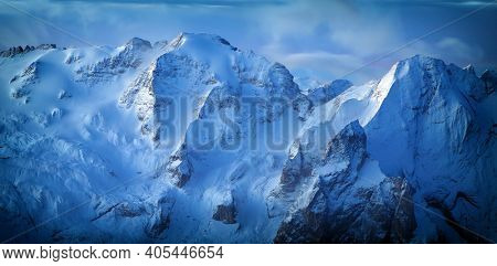 Early morning landscape of Marmolada summit with first rays in Dolomites in winter, Dolomites, Italy