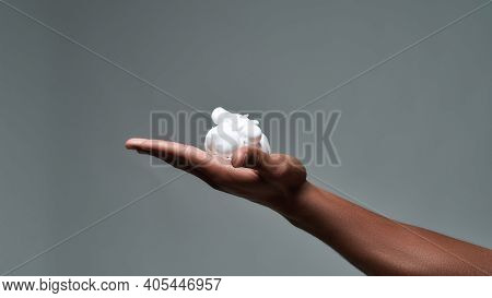 Close Up Of Hand Of Young African American Man Holding Shaving Foam, Ready To Shave Isolated Over Gr