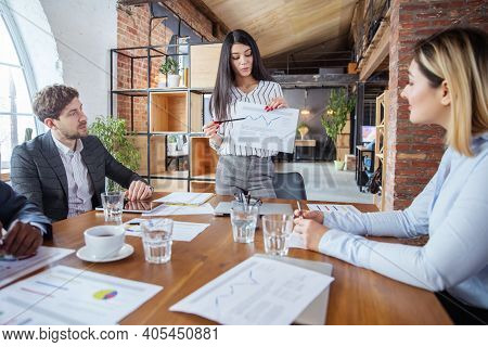 Increase. Diverse Group Of Co-workers Having Casual Discussion In Office. Executives During Friendly