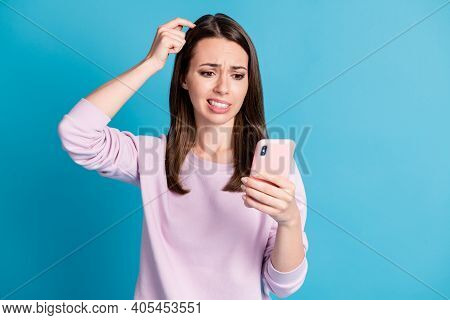 Photo Of Cute Displeased Unhappy Young Woman Hold Telephone Hand Head Unsure Read News Shark Eat Man