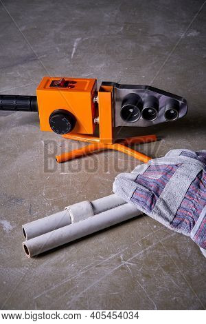 Soldering Iron For Polypropylene Pipes Next To Polypropylene Pipes And Gloves