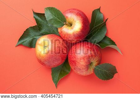 Red Apples With Leaves Over Paper Background. Gala Apple Composition. Top View