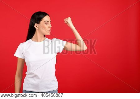 Strong Woman As Symbol Of Girl Power On Red Background, Space For Text. 8 March Concept