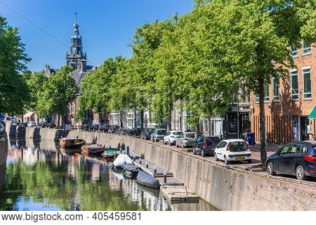 Gouda, Netherlands - May 21, 2020: Canal With Little Boats Leading To The Sint Jans Church In Gouda,