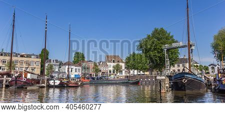Gouda, Netherlands - May 21, 2020: Panorama Of Historic Ships And Lock In The Harbor Of Gouda, Nethe