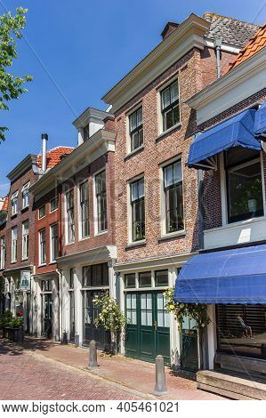 Gouda, Netherlands - May 21, 2020: Street With Old Houses In The Historic Center Of Gouda, Netherlan