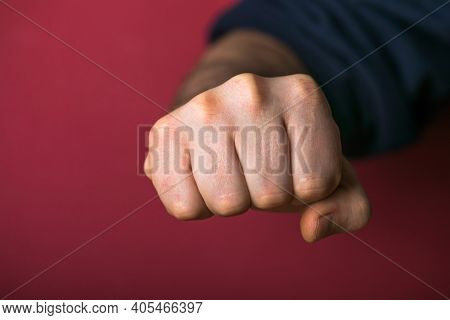 Fist. Man L Fists Clenched In Anger. Mans Hands With Fist Gesture Front Side Isolated On Red Backgro