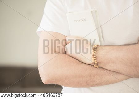 The Christian Holds The Bible In His Hands. Reading The Bible. The Concept Of Faith, Spirituality An