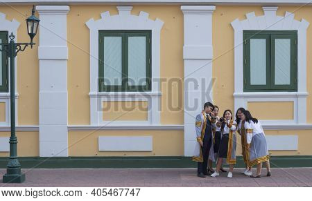 Bangkok, Thailand - August 29,2020 : Young Asian College Students Group In Graduation Gowns Having F