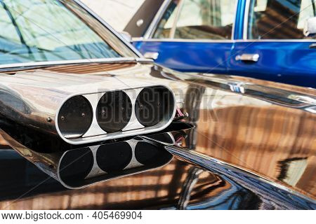 The Throttle On The Hood Of The Muscle Car Close-up.