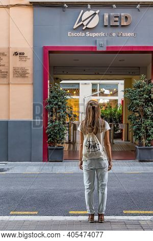 Barcelona, Spain - September 22, 2014: A Girl Stands In Front Of The Entrance Of The Ied Design High