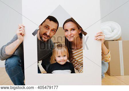 Family Portrait, Taken Through House Resembling Frame