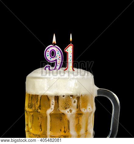 Number 91 Candle In Beer Mug For Birthday Celebration Isolated On Black