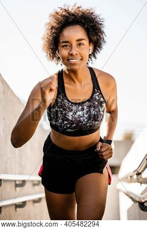 Portrait Of Afro Athlete Woman Running And