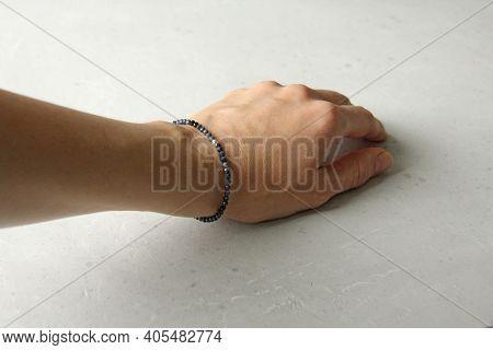Sapphire Bracelet. A Bracelet Made Of Stones On A Hand From A Natural Stone Sapphire. Bracelet Made