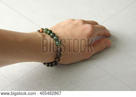 Bracelet Made Of Wooden Beads On A Woman's Hand, Bracelet Made Of Natural Stones, Natural Nephritis.